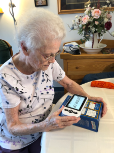senior using digital magnifier